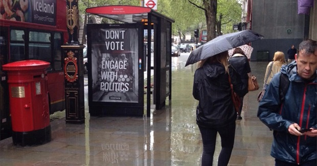 Activists Subvert London Billboards: Don't Vote, Engage With Politics, Take to The Streets
